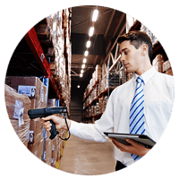 Employee checks inventory with barcode scanner and tablet in distribution center