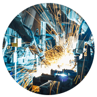 Industrial manufacturing sparks from equipment.