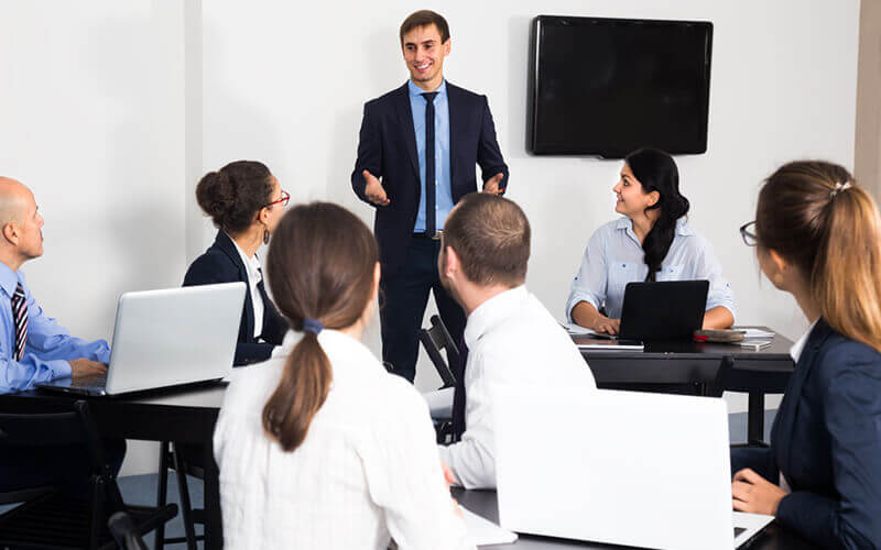 Manager presents new concept in business meeting