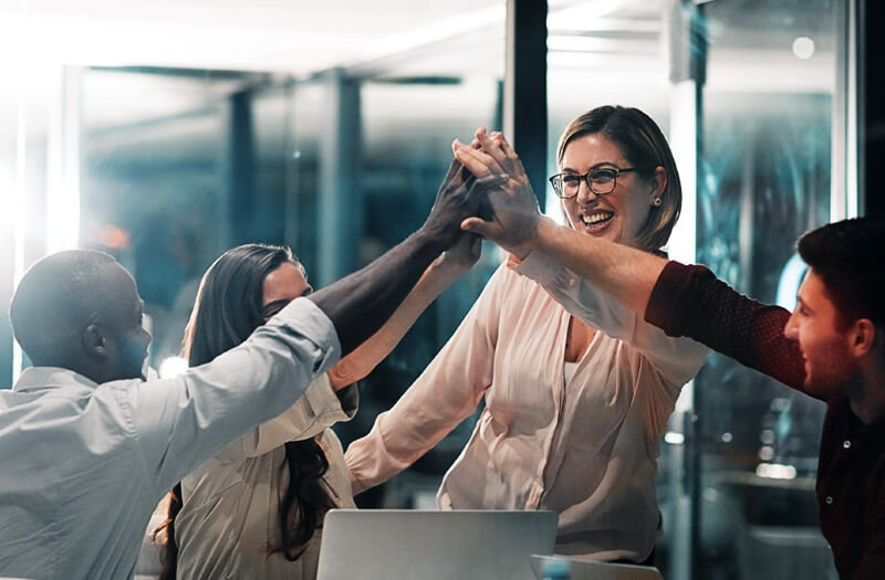 Business team give eachother high five