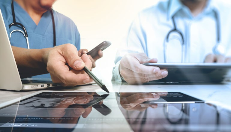 Healthcare professionals using devices
