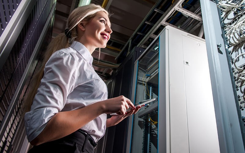IT engineer in data center evaluating infrastructure