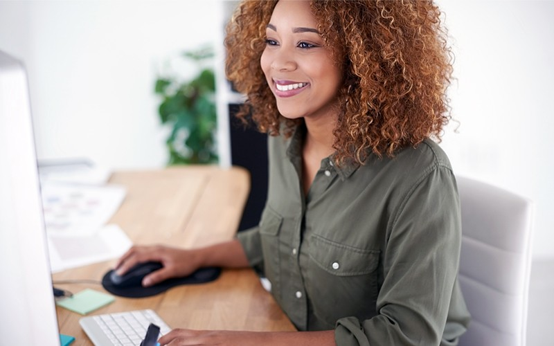 Businesswoman viewing items in the online marketplace on computer